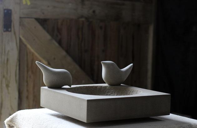 stone birds on birdbath