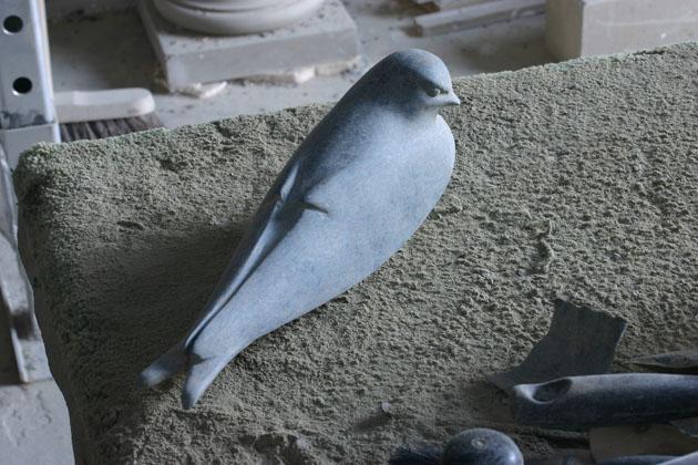 Working on a bird sculpture