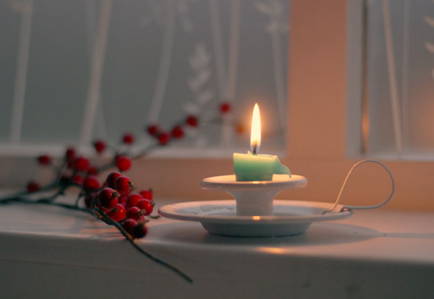 winter berries and candlelight