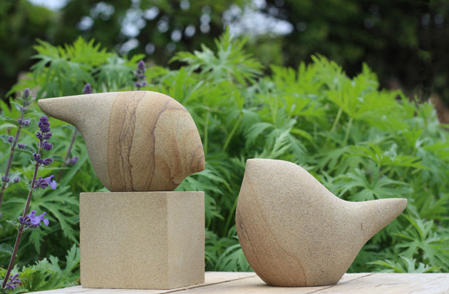 Birdlets sculpture in solid stone