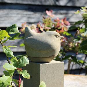 Little perched bird sculpture