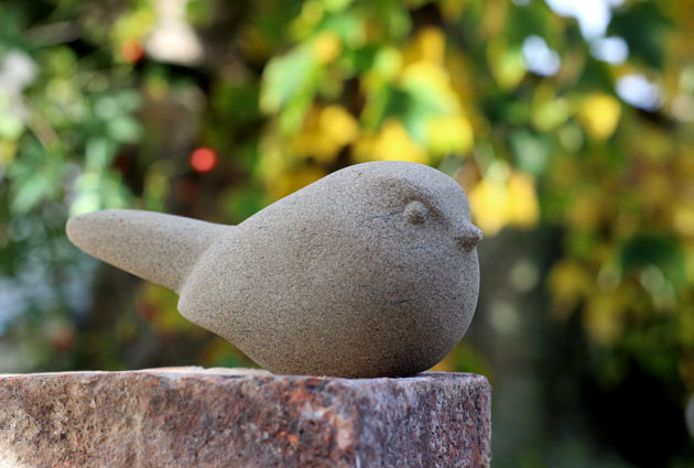 Bird stone sculpture