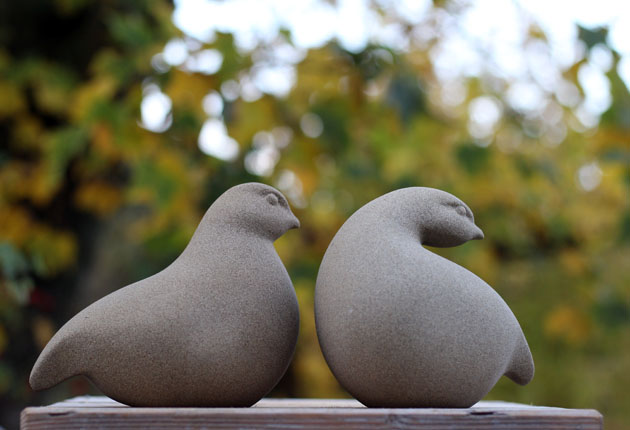 A pair of Patridges sculpture