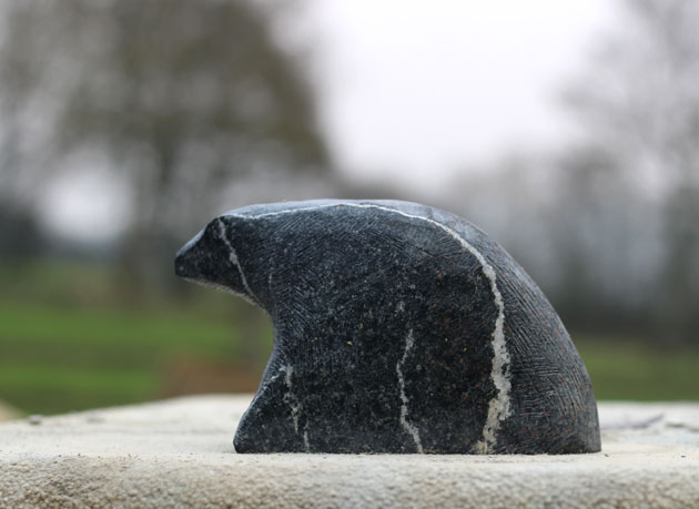 Carving a bear sculpture