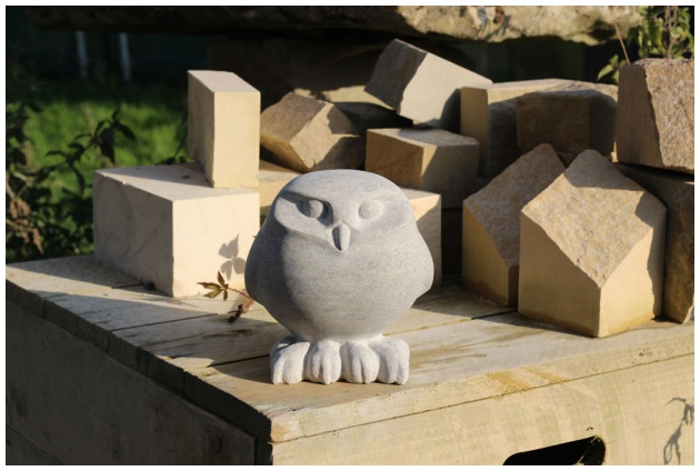 Litttle Owl stone sculpture