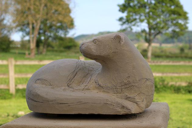 carving an otter sculpture