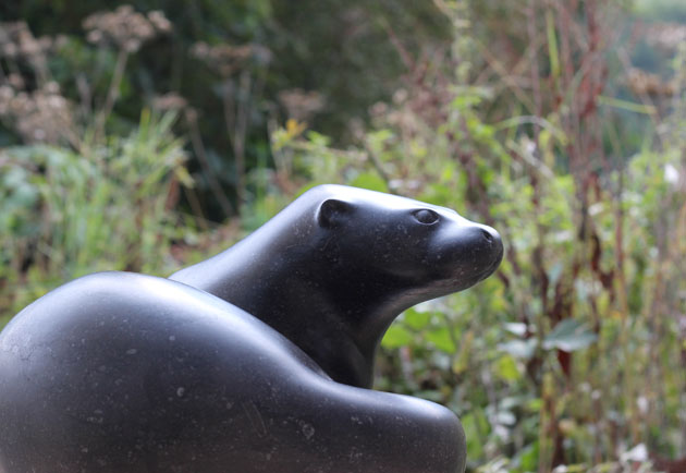 Curled Otter sculpture