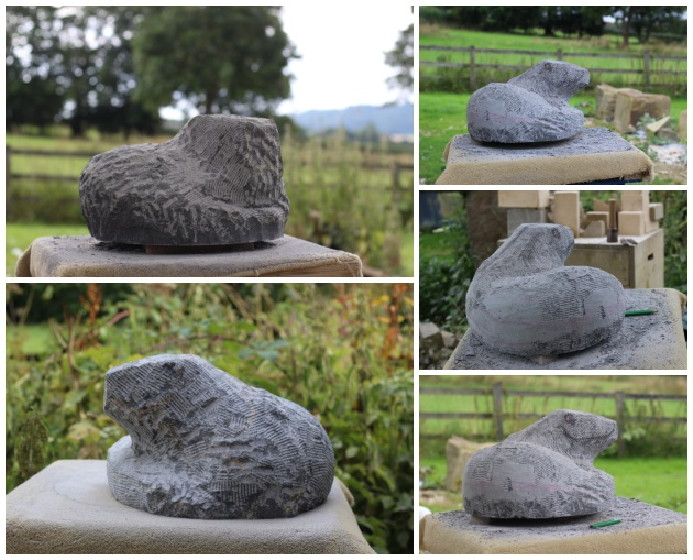 Stages of carving an otter sculpture