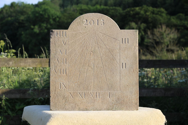 Sundial carved with numerals