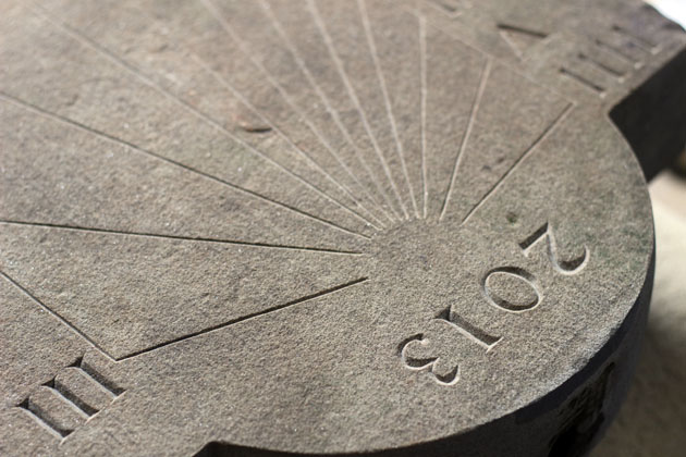 detail of the numerals carved on the sundial